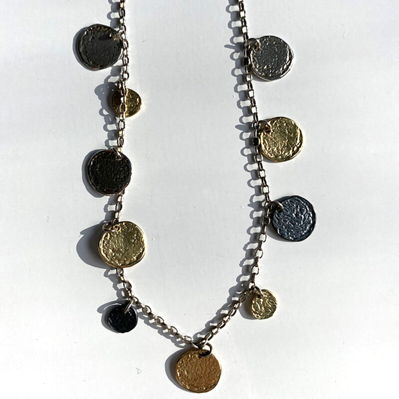 Sterling silver necklace with silver and gold plated discs