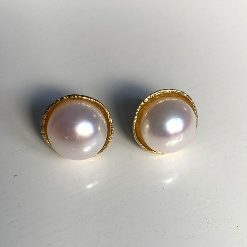 Large round pearls set in gold plated studs